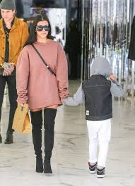 Kourtney rocking her overknee boots with kids in tow - no excuse for us!