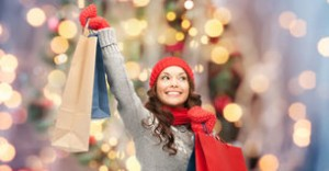 happy-woman-winter-clothes-shopping-bags-holidays-x-mas-sale-people-concept-young-asian-over-christmas-tree-lights-59583118
